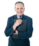 Welldressed corporate person holding document Stock Images
