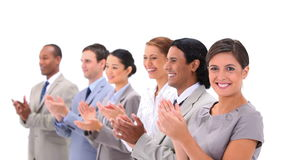 Welldressed people applauding Stock Images