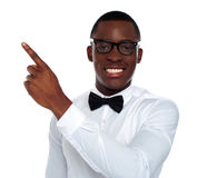 Welldressed young person pointing away Royalty Free Stock Photography