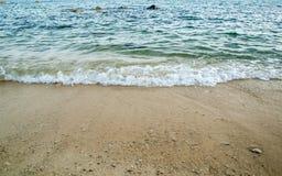 Welle auf dem Sand Stockfoto