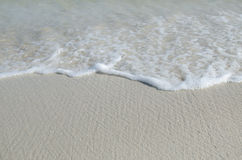Welle auf dem Strand Stockfotografie