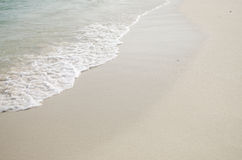 Welle auf dem Strand Stockbilder