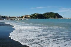 Welle auf dem Strand Stockbild