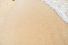Welle und Sand Lizenzfreie Stockfotos