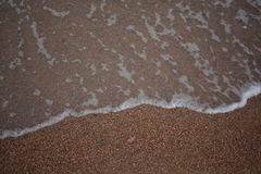 Wellen vor dem hintergrund Sand Wellen vor dem hintergrund des Sandes Lizenzfreie Stockfotografie