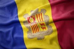 Wellenartig bewegende bunte Flagge von Andorra Lizenzfreie Stockfotografie