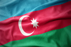 Wellenartig bewegende bunte Flagge von Azerbaijan Lizenzfreie Stockfotos