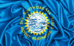 wellenartig bewegende Flagge 3d von South Dakota stockbilder