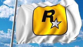 Wellenartig bewegende Flagge mit Rockstar Games-Logo Wiedergabe Editoial 3D Lizenzfreie Stockfotos