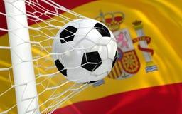 Wellenartig bewegende Flagge und Fußball Spaniens im Zielnetz Lizenzfreies Stockbild