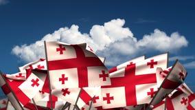 Wellenartig bewegende Georgia Flags lizenzfreie abbildung