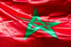 Wellenartig bewegende Gewebe-Flagge von Marokko Lizenzfreies Stockbild