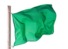 Wellenartig bewegende grüne Flagge über Weiß Stockbild