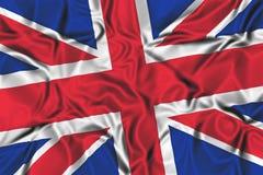 Wellenartig bewegende Markierungsfahne des Vereinigten Königreichs Lizenzfreie Stockfotos