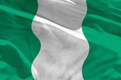 Wellenartig bewegende Nigeria-Flagge für die Anwendung als Beschaffenheit oder Hintergrund, die Flagge flattert auf dem Wind stockbild