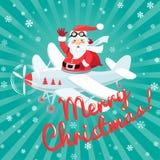 Wellenartig bewegende Santa Claus, die im Flugzeug mit dem Sack voll vom presetn fliegt Stockfotos