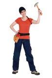 Wellenartig bewegender Hammer der Frau in der Luft Lizenzfreies Stockfoto