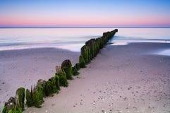 Wellenbrecher-Sonnenuntergang Lizenzfreie Stockfotografie