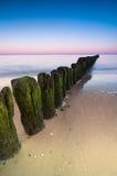 Wellenbrecher-Sonnenuntergang Lizenzfreie Stockfotos