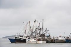 Wellfleet Harbor fishing boats. Fishing boats are gathered in Wellfleet Harbor, Massachusetts Stock Images