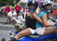 Wellfleet, Massachusetts, USA-July 4, 2014: Two young women riding on a motorcycle in the Wellfleet Stock Images