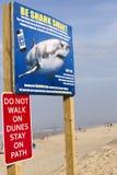 Wellfleet, Massachusetts /USA-8/11/18: Shark alert sign at Newcomb`s Hollow beach which was the site of a deadly shark attack. Shark alert sign at Newcomb`s stock image