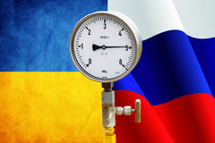 Wellhead Pressure Gauge. High pressure reading on gas wellhead isolated on flags Ukraine and Russia Stock Image