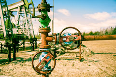 Wellhead and pump jack. Stock Photography