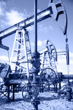Wellhead and pump jack. Royalty Free Stock Images
