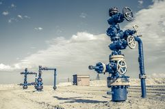 Wellhead with valve armature. Royalty Free Stock Photos