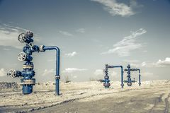 Wellhead with valve armature. Royalty Free Stock Image