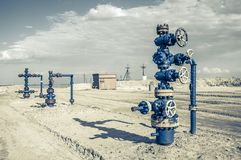 Wellhead with valve armature. Stock Images