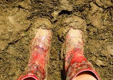 Wellies fangosos Wellington Boots en un festival de música Fotos de archivo libres de regalías