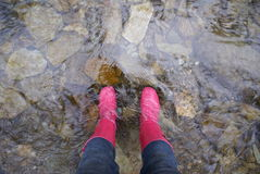 Wellies in the Water. Pink rain boots in a stream in the Great Smoky Mountains National Park Royalty Free Stock Images