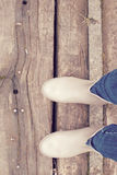 Wellies. Wellie boots on the wooden path stock photos