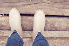 Wellies. Wellie boots on the wooden path royalty free stock photography