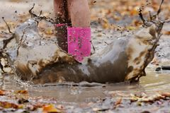 Wellington boots in puddle Stock Photos