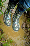 Wellington boots in a puddle Royalty Free Stock Image