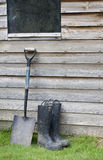 Wellington boots and shovel ready for work Stock Photography
