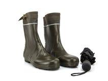Wellington boots with umbrella Stock Photos