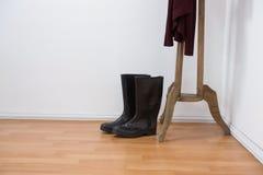 Wellington boots on wooden floor Stock Photos