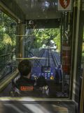 Wellington Cable Car driver looks ahead down the tracks through the cabin windshield royalty free stock images