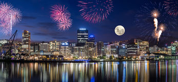 Wellington City at Night. Wellington harbor cityscapes with full moon and fireworks Stock Photos
