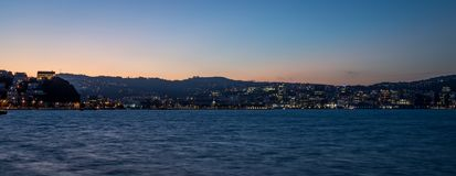 Wellington At Dusk, New Zealand Capital Night Panorama. Wellington City as seen from oriental bay at dusk with a little bit of color left from the sunset and the stock photography