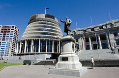 Parliament of New Zealand. WELLINGTON - FEB 25: The bronze statue of Richard John Seddon and the Beehive building - Parliament of New Zealand in Wellington city Stock Photos