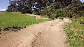 Mountain / dirt bike path, uphill, New Zealand 4k stock video footage