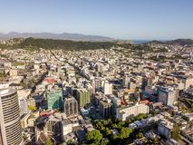 Greater Wellington City Aerial Point Of View. Wellington new zealand capital city and homes in golden sunset light royalty free stock photography