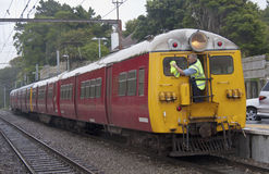 WELLINGTON, NEW ZEALAND - MAR 1ST: An engine driver cleans the w Royalty Free Stock Images