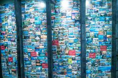 WELLINGTON, NEW ZEALAND - SEPTEMBER 5, 2018: Te Papa Tongarewa Museum with row of city pictures. Wellington attracts 1 million. Tourists annually stock photography