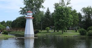 Wellington Park in Simcoe, Canada with lighthouse 4K. In Wellington Park in Simcoe, Canada with lighthouse 4K stock video